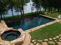 Blue with black aggregate, infinity edge gunite pool