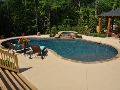Freeform gunite pool with rock waterfall