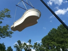 Fiberglass pool on crane