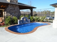 Freeform fiberglass pool with fountain
