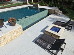 Geometric gunite pool with swim-up bar