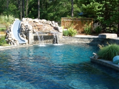 Gunite pool with rock waterfall & slide