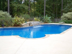 Lazy L Vinyl Pool with Stone Coping_ Water Feature