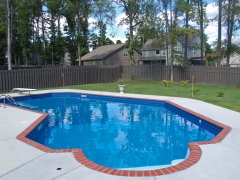 Lazy L Vinyl Swimming Pool with Brick Coping