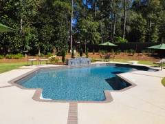 Lazy L Vinyl Swimming Pool with Brick Expansion Joints