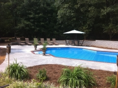 Lazy L Vinyl Swimming Pool_ Split Block Retaining Wall