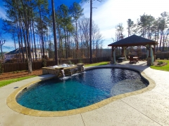 Oval gunite pool with raised spa