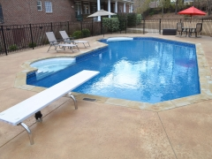 Small Lazy L Vinyl Swimming Pool_ Swimout_ Salt Pitted Stained Concrete Decking