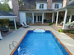 Small Vinyl Swimming Pool with Brick Coping
