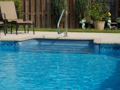 Vinyl Swimming Pool with Brick Coping_ Blue Pool Steps