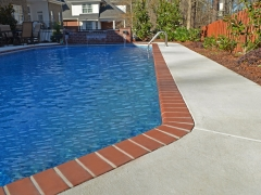 Vinyl Swimming Pool with Brick Hot Tub Enclosure