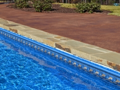 Vinyl Swimming Pool with Stone Coping_ Stained Decorative Decking
