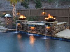 Fire Bowl_ Stone Hot Tub Enclosure_ Pete Alewine Pools Outdoor Showroom